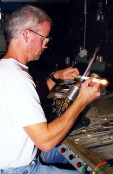 Researcher working with glass