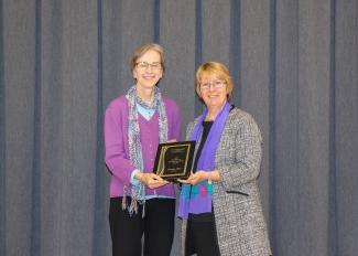 Pat Thiel with award